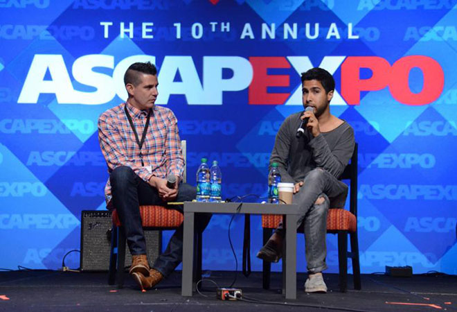 """HOLLYWOOD - MAY 2: ASCAP VP Pop/Rock Membership Marc Emert-Hutner, left, and Savan Kotecha speak at The Economics of a Hit Songwriter: Master Session with Savan Kotecha at the 2015 ASCAP """"I Create Music"""" EXPO at the Loews Hollywood Hotel on May 2, 2015 in Hollywood, California. (Photo by Tonya Wise/PictureGroup)"""