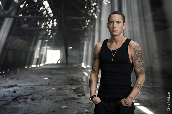 """EMINEM, 2009 This was taken at a warehouse in a dilapidated part of Detroit—a publicity shot for the """"Beautiful"""" video. We also went to the old Detroit Tigers stadium. Eminem is always focused and gives me time and space to capture iconic images."""
