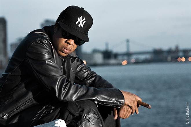 """JAY-Z, 2009 They were shooting the """"D.O.A."""" video. During a break, Jay-Z gave me some quality time. He's on the Brooklyn side of the East River, sitting on the rocks, smoking a cigar. He's serious but can also be easygoing. We had some laughs."""