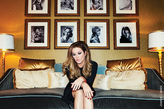 LISA MARIE PRESLEY, 2012 Lisa Marie was relaxing in her dressing room prior to a show at Nashville's Grand Ole Opry. There's something incredibly iconic about her. She's looking down at the set list. I love the image of the female country singers in the background.