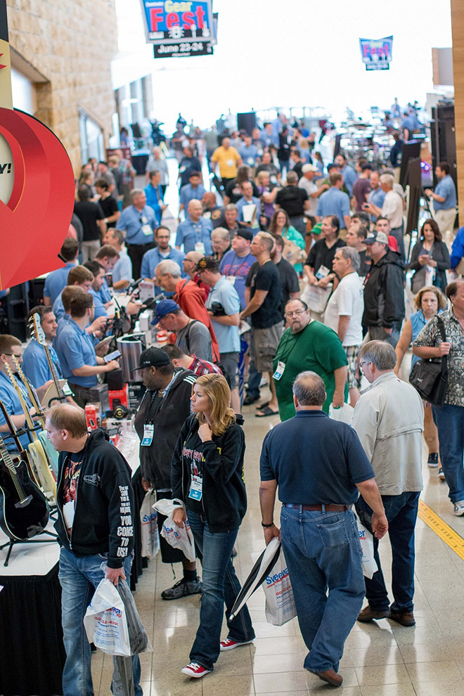 "Huge crowds throng the ""mall"" area surrounding GearFest's ""Deal Zone."""